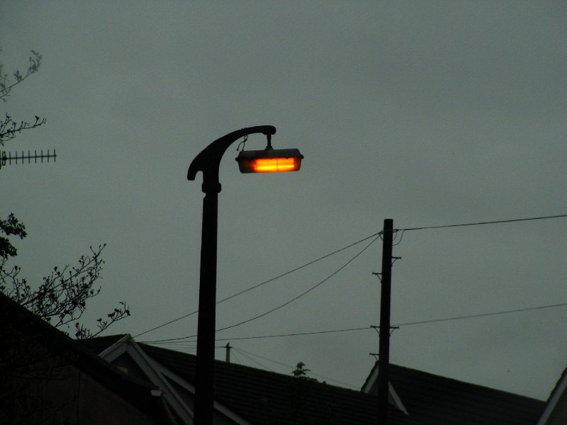 SOX Light In South Wales UK With Old Concrete Lamp Post